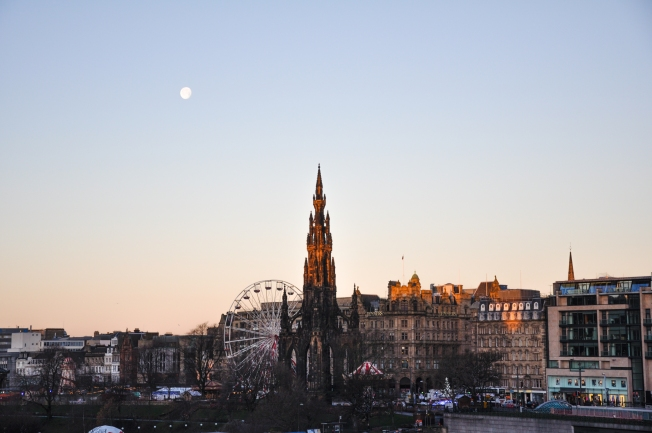A view of the Christmas fair down on Princes Street, still with the moon in sight